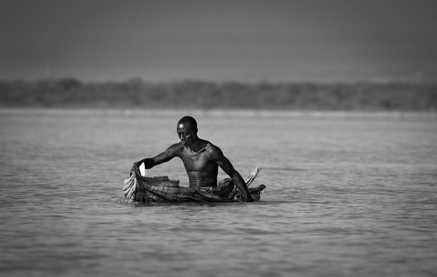 An Eye For Travel EyeEm Nature Lover Lake Baringo Riftvalley The Week on EyeEm Africa Day To Day Blackandwhite Documentary Fisherman Fishing Boat Hand Paddeling Kenya365 Leke Monochrome Nature One Person Paddeling Remote Reportage Sitting Water