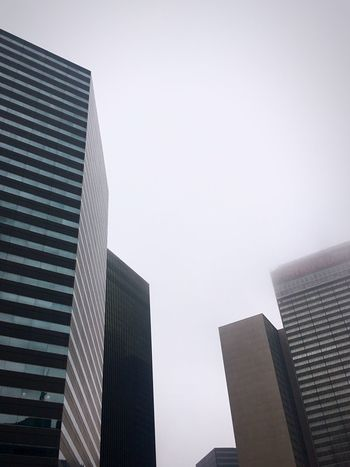 Looking up at some buildings Building Exterior Architecture Built Structure City Low Angle View Modern Skyscraper Clear Sky No People Outdoors Day Tall Sky Office Block (null)Hello World Downtown Check This Out Low Angle View Lookingup Cool Design Shapes EyeEm Best Shots Foggy Traveling Home For The Holidays EyeEm Ready