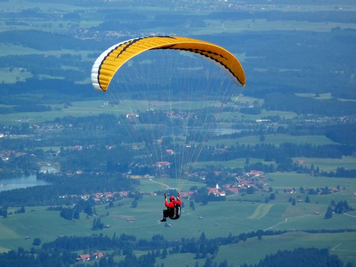 Man paragliding over landscape