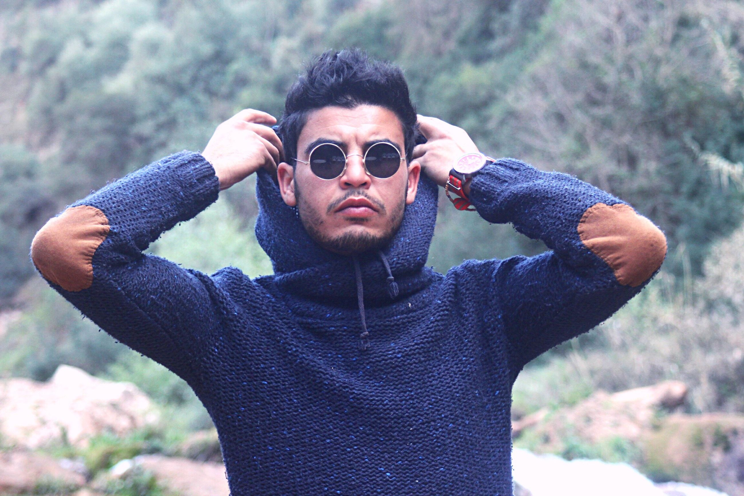 lifestyles, leisure activity, portrait, looking at camera, young adult, young men, focus on foreground, person, front view, headshot, sunglasses, close-up, mid adult men, holding, outdoors, day, casual clothing, mid adult