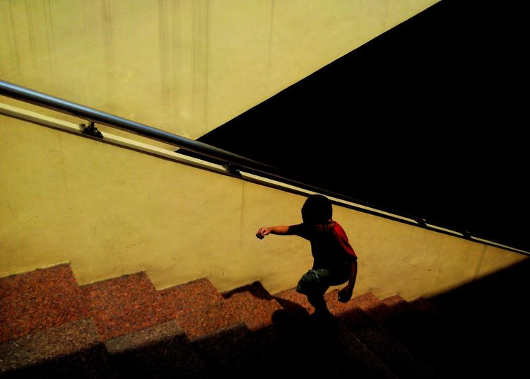 Boy walking up stairs