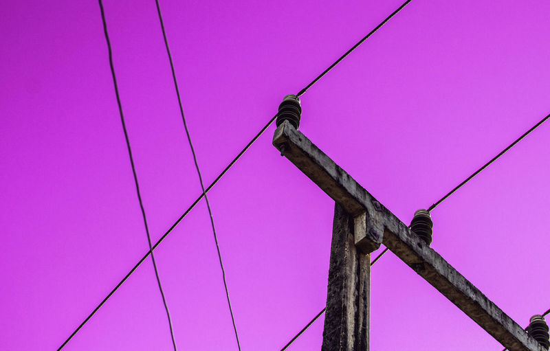 Week On Eyeem WeekOnEyeEm Abstract Cable Clear Sky Day Electricity  Fuel And Power Generation Low Angle View Maintenance Engineer No People Outdoors Perching Pink Color Power Supply Purple Sky Technology Telephone Line