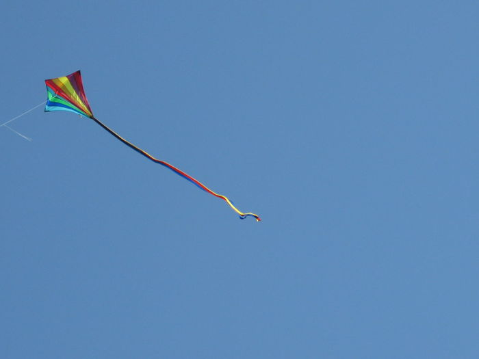 Hampstead Heath Kitehill Blue Clear Sky Copy Space Day Environment Flag Flying Freedom Kite Low Angle View Motion Multi Colored Nature No People Outdoors Sky Wind