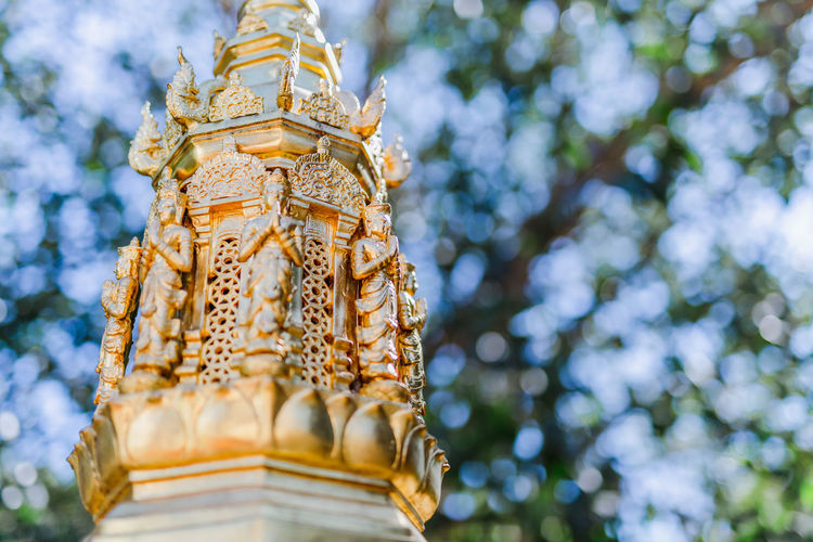 Close up buddist statue. Low Angle View Built Structure Architecture Belief Religion Spirituality Gold Colored No People Place Of Worship Building Day Focus On Foreground Building Exterior Tree Plant Nature Gold Outdoors Ornate Buddist Buddist Statue Culture