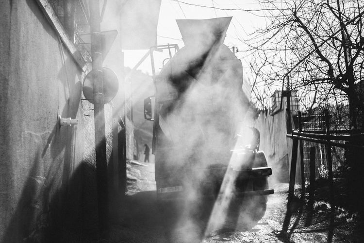 Camera - Canon 550D - Lens - 50 mm f/1.8 Blog : https://www.instagram.com/david_sarkisov_photography/ Built Structure Architecture Day Sunlight Tree Building Exterior Smoke - Physical Structure Nature Plant Sunbeam No People Outdoors Shadow Bare Tree City Building Sunny Air Pollution Pollution Blackandwhite Smog Urban Urbanphotography My Best Photo Analogue Sound Streetwise Photography