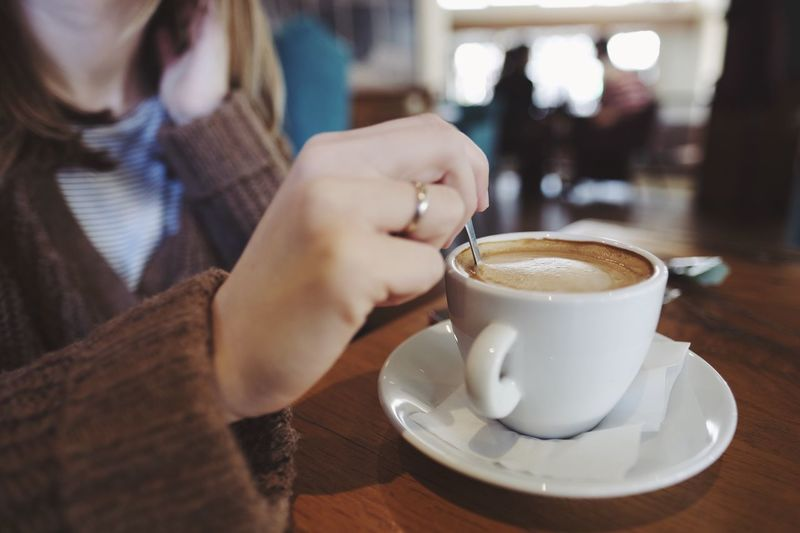 Coffee - Drink Coffee Cup Cafe Food And Drink Real People Close-up Drink Saucer Table Indoors  Cup One Person Holding Leisure Activity Human Hand Cappuccino Day Frothy Drink