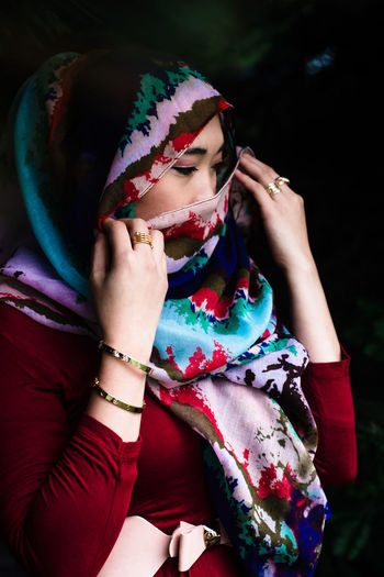 Woman holding colorful clothing