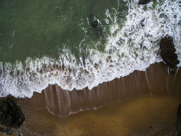 Drone view of sea waves at beach