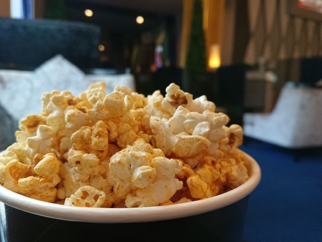 Popcorn and blur of cinema background. Holiday Relax Popcorn Cinema MOVIE Fun Snacks Blur Background EyeEm Selects Food And Drink No People Close-up Indoors  Snack Potato Chip