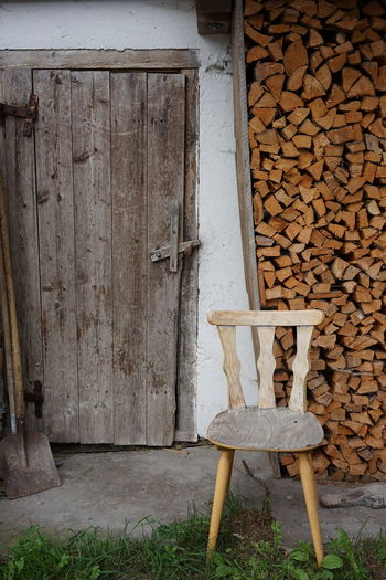 Stack of old wooden table against wall