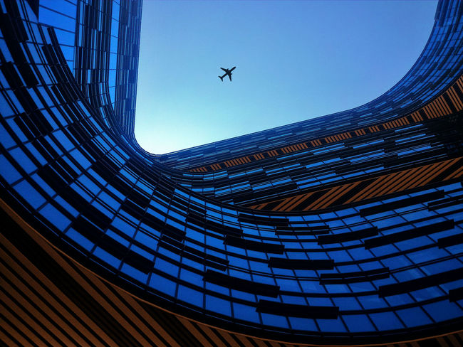 A relaxed afternoon... Airplane Blue Blue Sky Architecture Architecture_collection EyeEm Best Shots Eye4photography  Silhouette Fly Orange Color Light And Shadow Taking Photos Capture The Moment Air Vehicle Low Angle View Building Geometry Geometric Shapes Light Sky Lost In The Landscape Perspectives On Nature