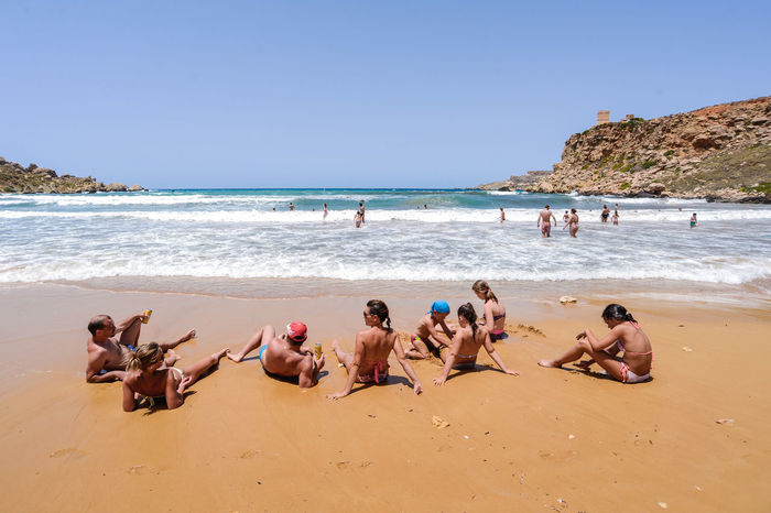 Malta Sand Beach Summertime Travel Beach Beauty In Nature Clear Sky Day Fun Golden Bay Horizon Over Water Large Group Of People Lifestyles Men Nature Outdoors People Real People Sand Scenics Sea Shore Sky Summer Turism Vacations Water Wave