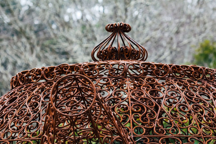 Focus On Foreground Close-up Pattern No People Design Metal Day Nature Outdoors Brown Religion Plant Decoration Creativity Shape Belief Celebration Craft Floral Pattern Art And Craft Ornate Tea