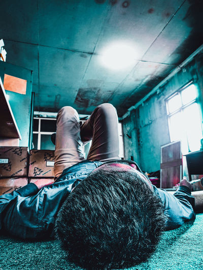Low section of man lying on floor