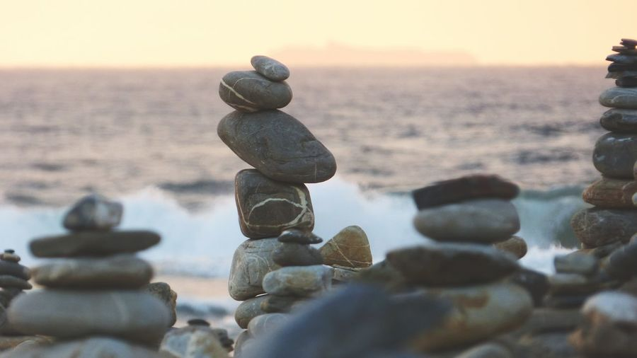 EyeEm Selects Balance No People Water Sunset Tranquility Nature Stack Outdoors Beach Sea Day Zen Rocks Sunset Zen Rocks Rock - Object Zen Rock At Beach Summer Your Ticket To Europe The Week On EyeEm