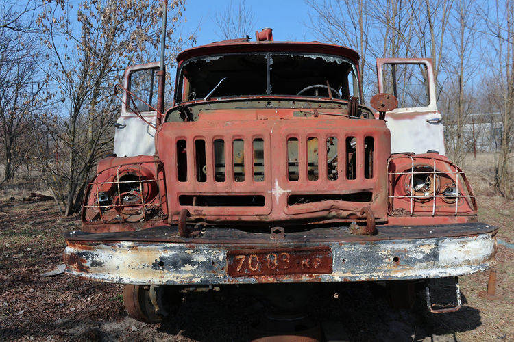 Old rusty train against trees