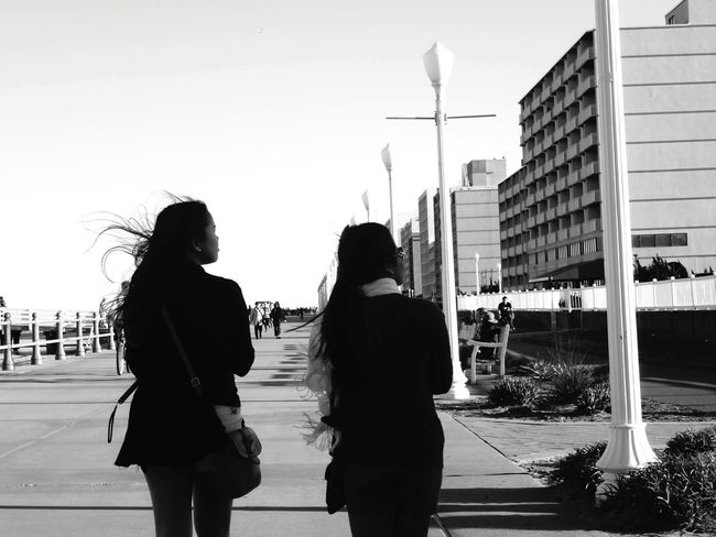 JO AND KIM. Friend Friendship. ♡   Friends ❤ Leisure Activity Walking City Outdoors City Life Togetherness Clear Sky Beach Tourist Person Walking Around Taking Pictures Walking Around Blackandwhite Black & White