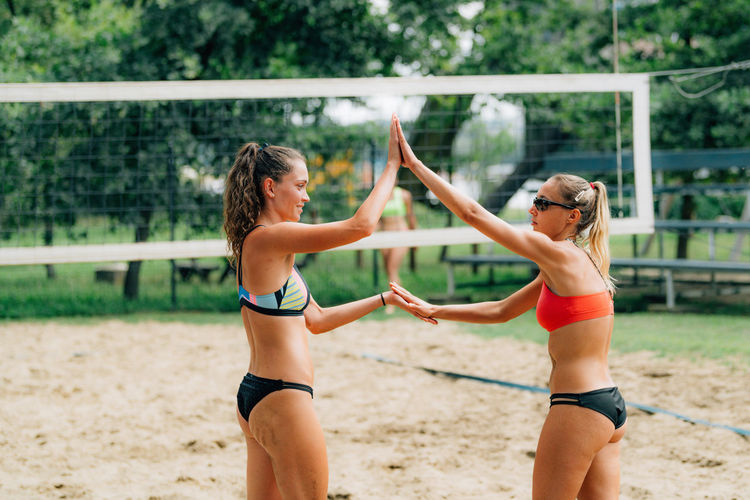 Beach volleyball players after the match, congratulating each other