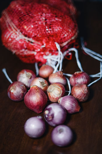 Fresh onion in malaysia during preparation of eid mubarak on a wooden textured background