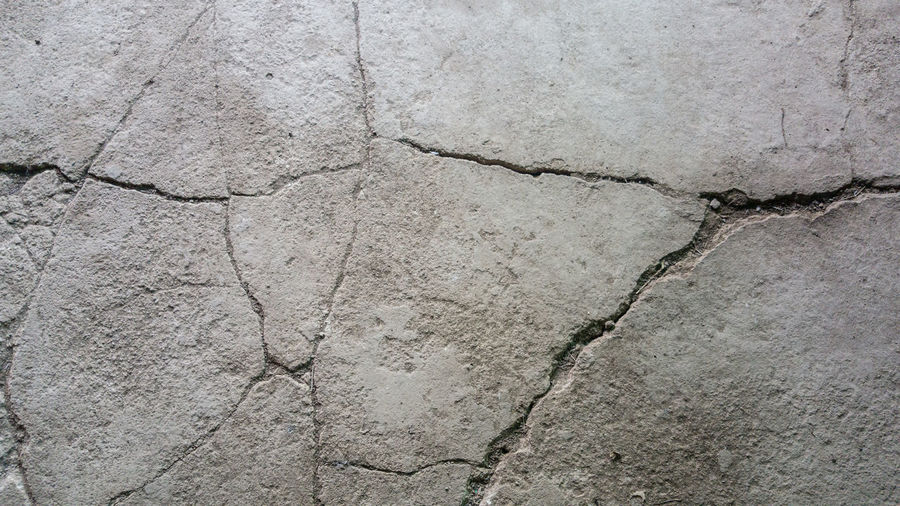 Abstract Abstract Backgrounds Architecture Backgrounds Cement Close-up Concrete Construction Material Cracked Day Flooring Full Frame Gray Marble Nature No People Outdoors Pattern Paving Stone Rough Solid Stone Material Textured  Textured Effect Wall - Building Feature