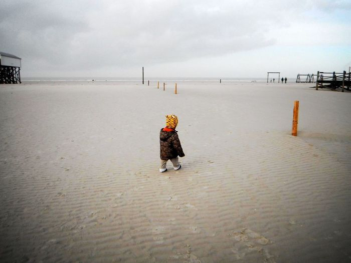 Full Length Casual Clothing Walking Sky Warm Clothing Water Tranquil Scene Scenics Nature Cloud Day Beauty In Nature Outdoors St. Peter Ording Eiderstedt Nordfriesland Northsea Nordseeküste Germany