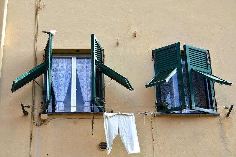 house exterior details Details And Colors Yellow Facade Genova Liguria,Italy Italian Riviera Pigeon Windows Window Hanging Clothesline No People Drying Day Low Angle View Architecture Built Structure Outdoors Close-up
