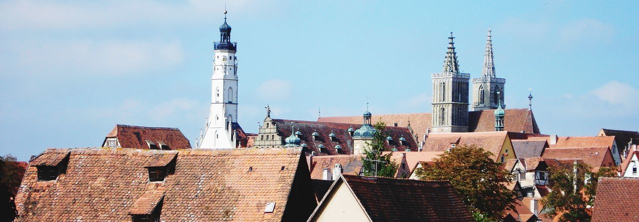 Town Skyline With Bell Tower And Tiled Roofs
