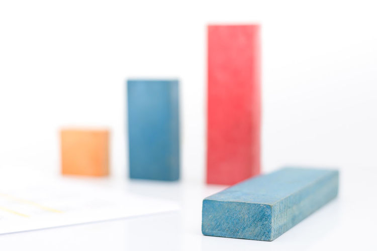 Close-up of multi colored toy blocks against white background