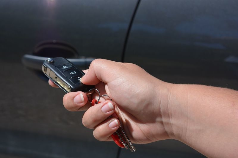Close-up of woman hand holding car