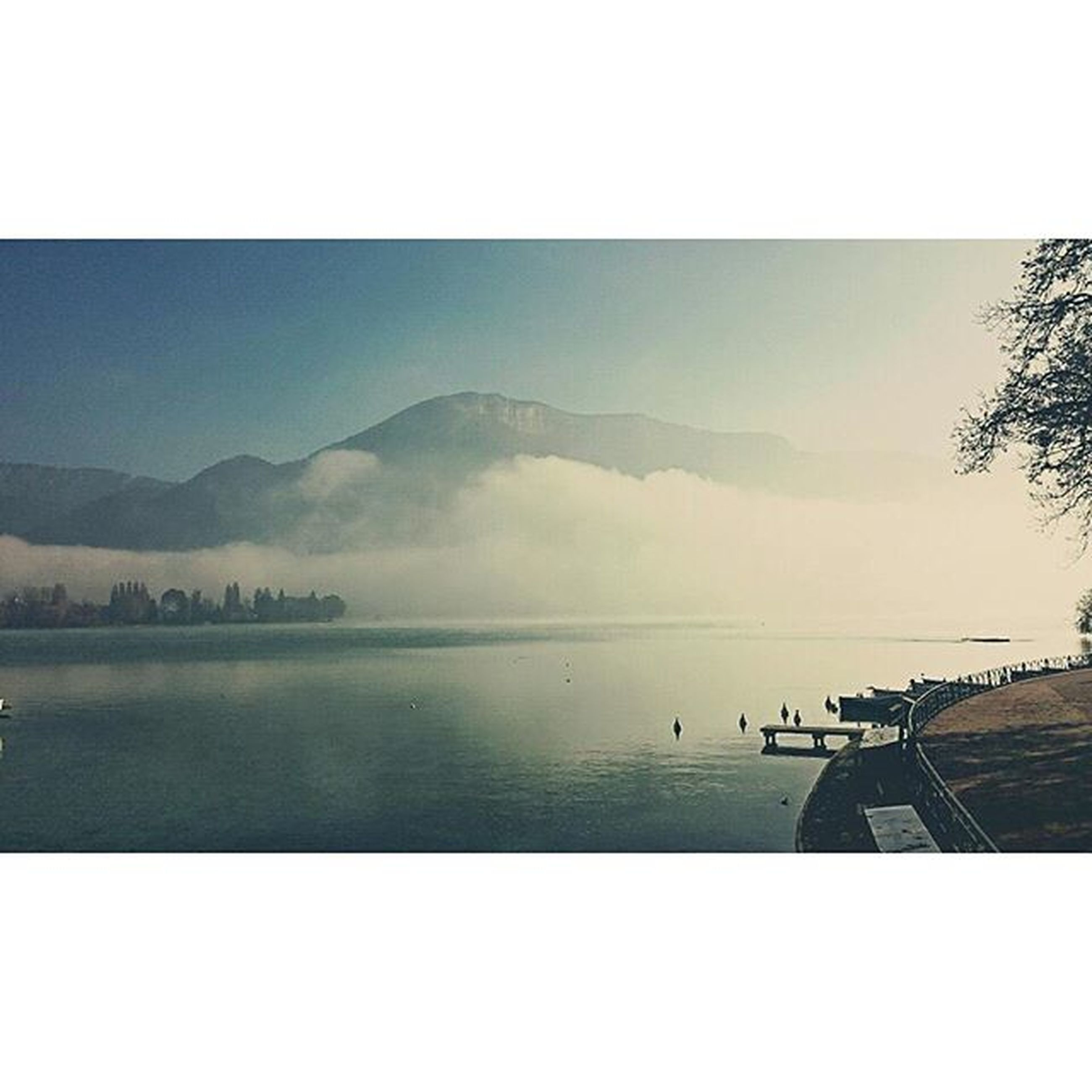 transfer print, water, auto post production filter, sky, tranquil scene, scenics, tranquility, sea, beauty in nature, lake, nature, mountain, idyllic, reflection, cloud - sky, outdoors, calm, horizon over water, no people, cloud