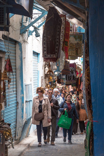 TUNIS, TUNISIA - APRIL 3: Busy and crowded market, or souk, in the medina of Tunis, Tunisia on April 3, 2018 Tunisia North Africa Africa Tunisian Travel Travel Destinations Tourism Culture Architecture Medina Tunis Souk Market Bazaar People Retail  Real People Adult Women Men Woman Man Casual Clothing Street Market