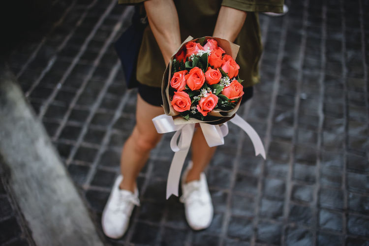Good vibes. EyeEm Best Shots EyeEm Selects Market Streetphotography Canon Goodvibes Human Hand Flower Head Flower Low Section Bouquet Women Red Holding Rose - Flower Basket Groom Bunch Of Flowers Flower Arrangement Florist Flower Shop Valentine Day - Holiday Bride Vase A New Beginning