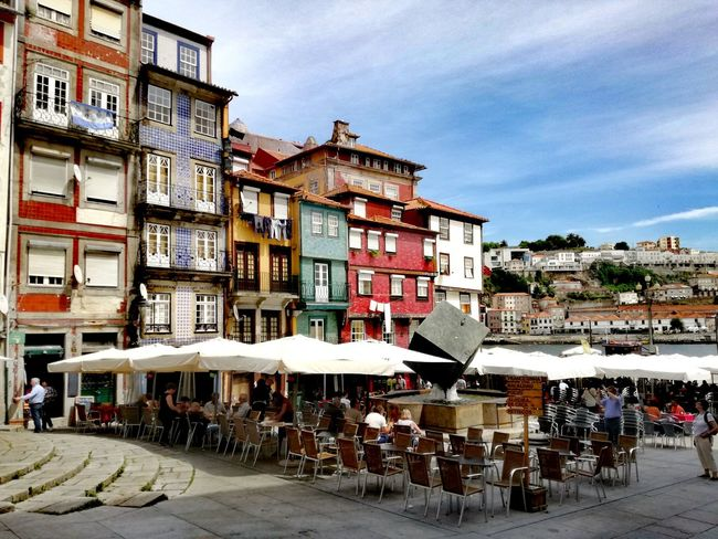 Architecture Outdoors Building Exterior Street Day Built Structure Travel Destinations City Sky Town Awning People Cityscape Lazyafternoon Porto Portugal_em_fotos Portugal Is Beautiful Street Photograpy Terrace Scene Street Photo