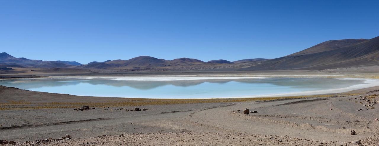 Reflection Arid Climate Beauty In Nature Blue Clear Sky Climate Copy Space Day Environment Land Landscape Mountain Mountain Range Nature No People Non-urban Scene Outdoors Remote Salt Flat Scenics - Nature Sky Tranquil Scene Tranquility Water