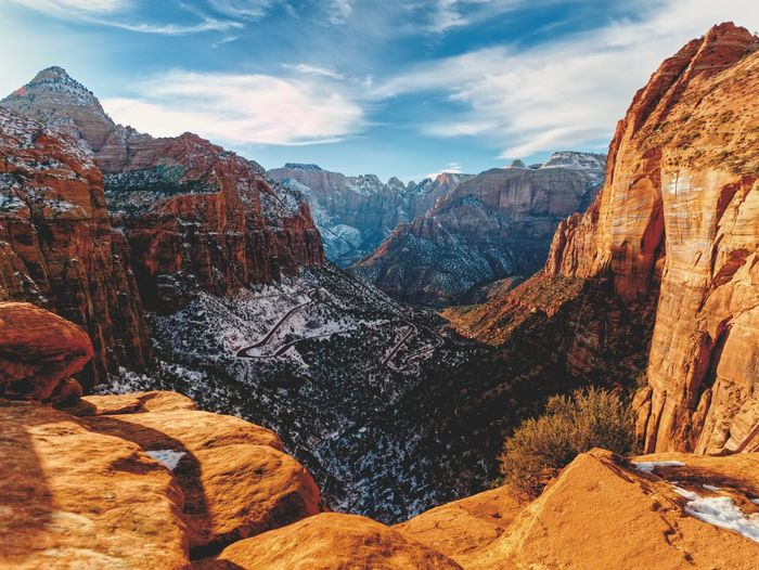 I like to hike - especially when rewarded with views like this! #whataview Zion National Park Sandstone High Angle View Overlook Canyon Mountain Sky Beauty In Nature Mountain Range Scenics - Nature Nature Tranquil Scene Tranquility Travel Destinations Idyllic Rock
