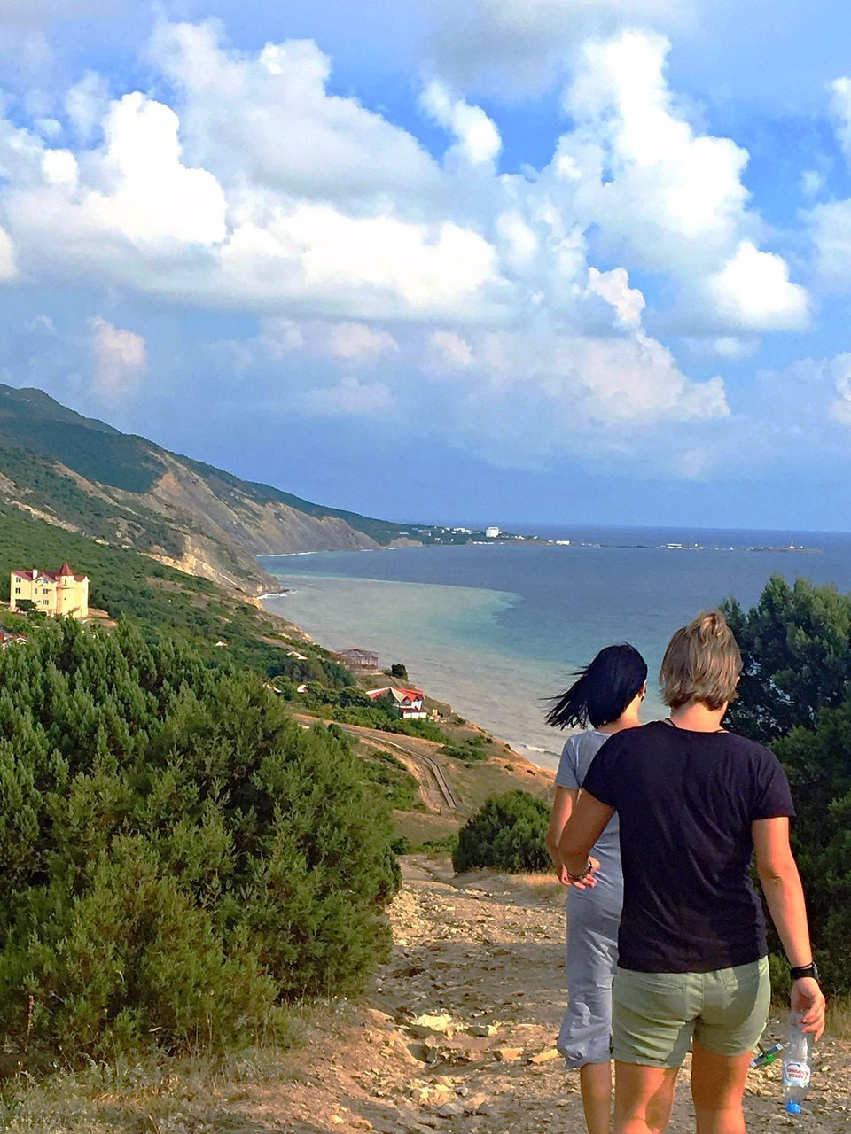 rear view, sky, cloud - sky, real people, leisure activity, water, lifestyles, beauty in nature, scenics - nature, mountain, men, day, nature, people, togetherness, land, plant, women, adult, outdoors, couple - relationship, looking at view