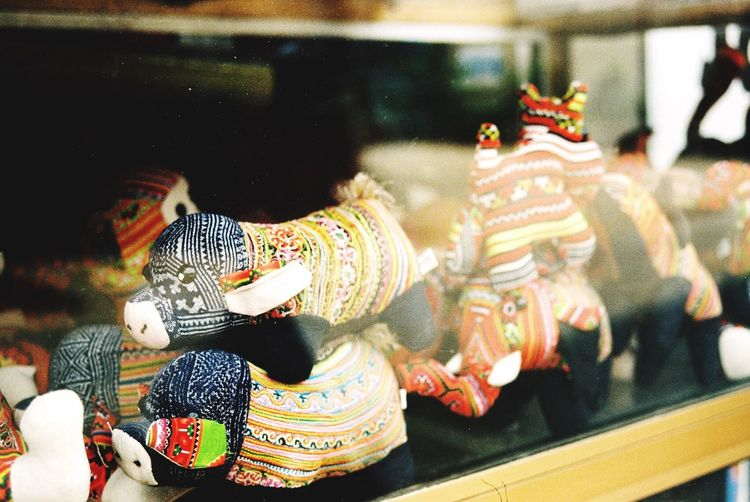 Chinese Dragon Toys Seen Through Glass At Store For Sale