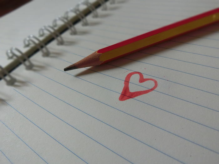 Close-Up Of Heart Shape Drawing And Pencil On Paper