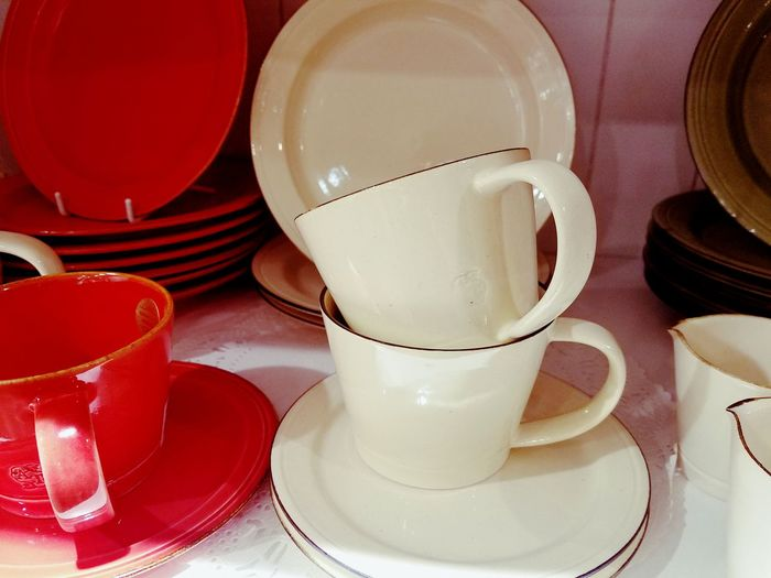 Close-up of cups and saucers on table