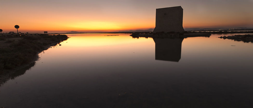 Tower of Tamarit at sunset in the town of Santa Pola, province of Alicante in Spain Alicante European  SPAIN Santa Pola Spanish Beauty In Nature Dawn Nature No People Outdoors Reflection Scenics Sea Silhouette Sky Sun Sunset Tamarit Tower Of Tamarit Tranquil Scene Tranquility Water