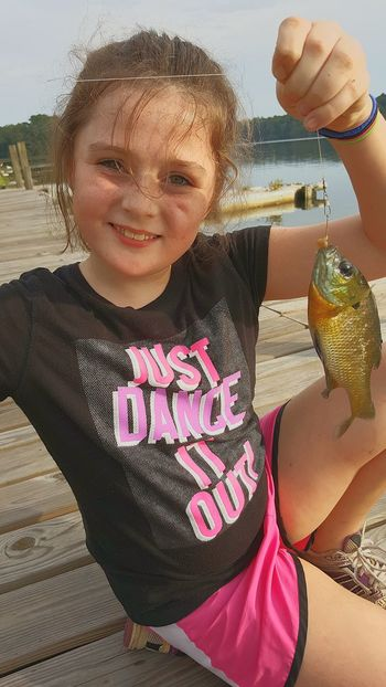 Childhood Water Close-up Human Hand Fishing Catching Fish Outdoor Activity Fishing Dock Learning Girl Fishing Excitement Smiling Enjoyment Emotions Happiness Bream Perch Outdoors Children Only Portrait Child One Person Happiness Day Recreation  Pet Portraits