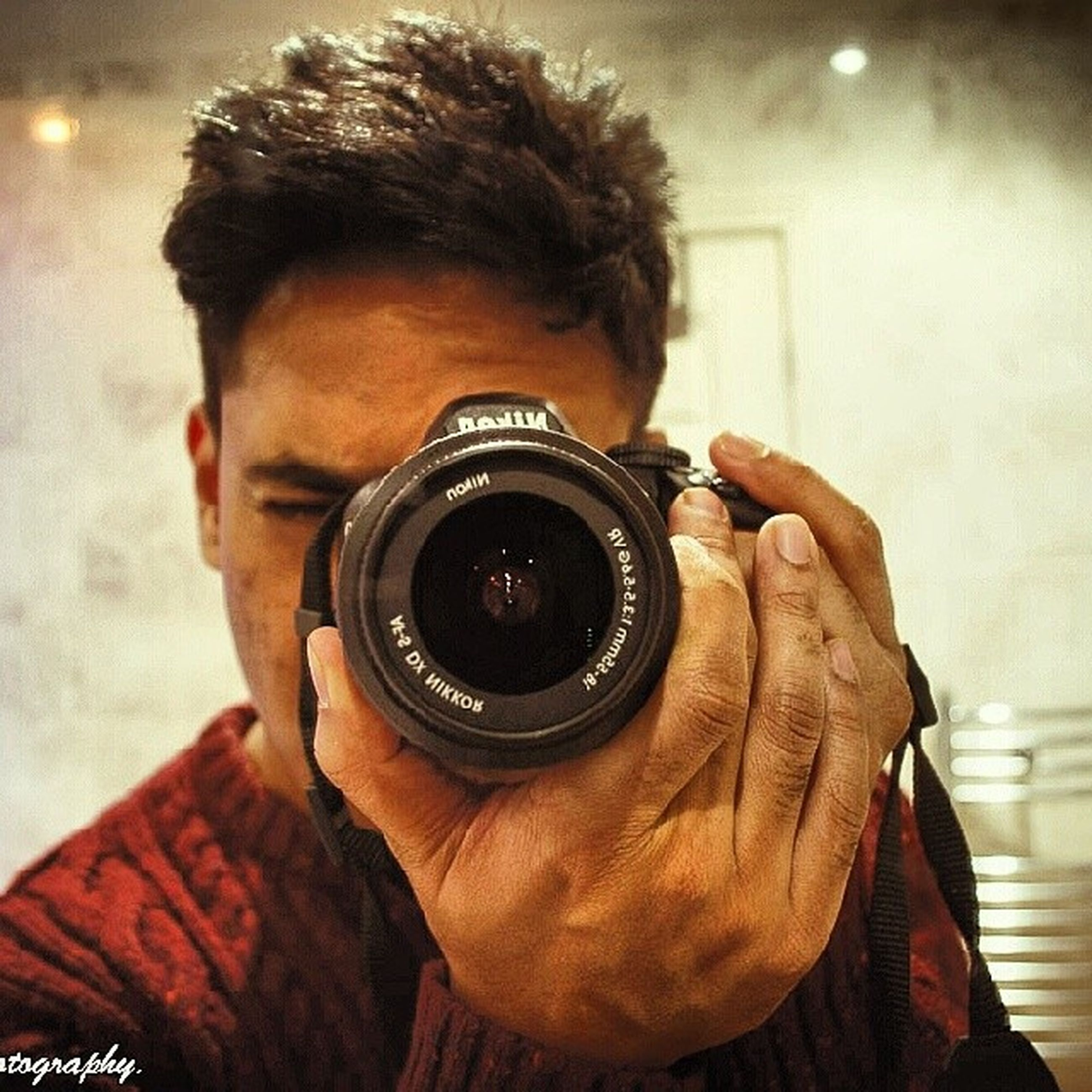 photography themes, technology, lifestyles, indoors, headshot, holding, leisure activity, photographing, young men, camera - photographic equipment, wireless technology, young adult, men, close-up, digital camera, smart phone, communication, mobile phone