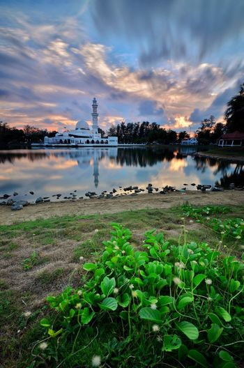 Beautiful mosque Masjid Tengku Tengah Zaharah Masjid Terapung Floating Mosque White Mosque Islamic Architecture Dome Minaret Green Color Green Leaves Waterfront Reflection Lakeside Landscape Nature Landscape_Collection Moving Clouds Sky Jumaat Friday Islam Muslim Water Sunset Tree Beauty Awe Multi Colored Long Exposure Lake
