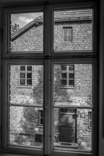 Auschwitz Window Glass - Material Architecture Transparent Built Structure Building Day No People Indoors  House Plant Closed Tree Safety Nature Reflection Security Glass Window Frame