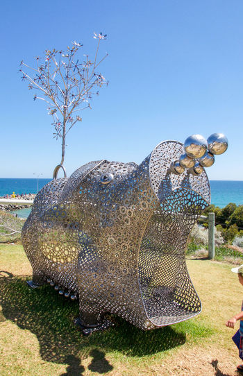 Metal hippo sculpture on the Cottesloe Beach foreshore during Sculptures by the Sea in Western Australia. Art Arts And Entertainment ArtWork Beach Child Cottesloe Creativity Culture Event Festival Foreshore Hippo Hippopotamus Indian Ocean Interactive  Interactive Art Metal Metalwork Mouth Nature People Sculpture Sculptures By The Sea Walk Through Western Australia