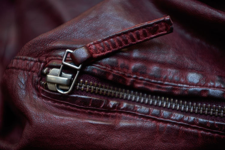 Red Bag Belt  Black Color Brown Casual Clothing Close-up Clothing Detail Fashion Focus On Foreground Fujifilm X100f Full Frame Indoors  Leather Leather Jacket No People Personal Accessory Purse Safety Selective Focus Technology Textile Zipper