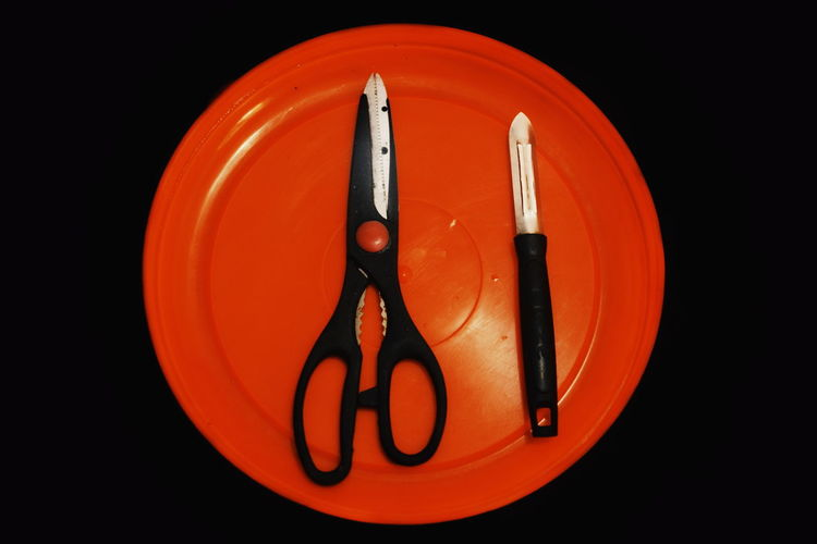 Indoors  Close-up Black Background Studio Shot No People Red Fork Still Life Eating Utensil Kitchen Utensil Black Color Food And Drink Food Orange Color Knife Communication Illuminated Plate Household Equipment Table Knife Setting