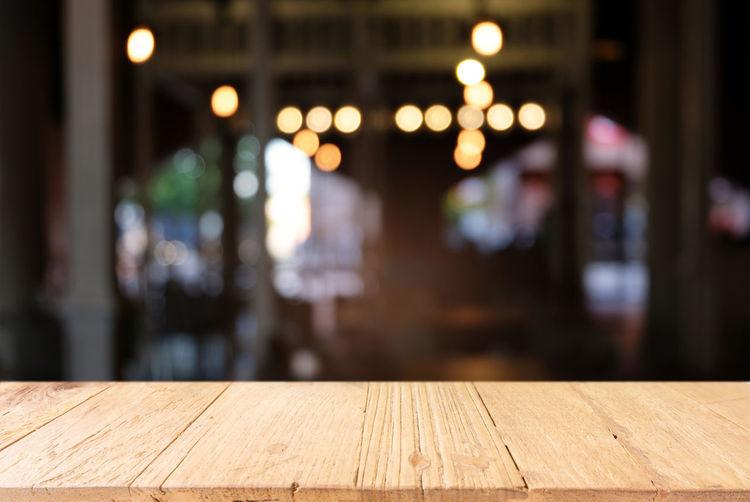 Architecture Bar - Drink Establishment Built Structure Business Cafe Defocused Empty Flooring Focus On Foreground Illuminated Incidental People Indoors  Lighting Equipment Luxury Night Nightlife Restaurant Seat Table Wood - Material