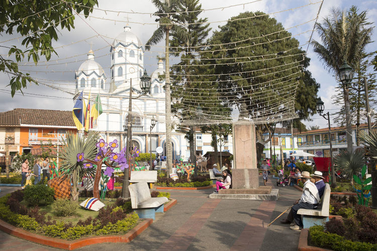 Scene from the main square in Filandia, Quindio, one of the picturesque towns in Colombia's coffee region. Andes Colombia Architecture Building Exterior Built Structure Coffee Region Day Dome Outdoors Place Of Worship Religion Small Town Spirituality Tree