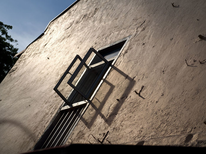 Architecture Building Exterior Built Structure Day Light And Shadow Of Opened Window Low Angle View No People Outdoors Shadow Sky Sunlight